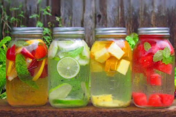 How to make natural flavor-infused water. Excellent source of hydration with the health benefits of fresh fruit, basil and mint leaves.