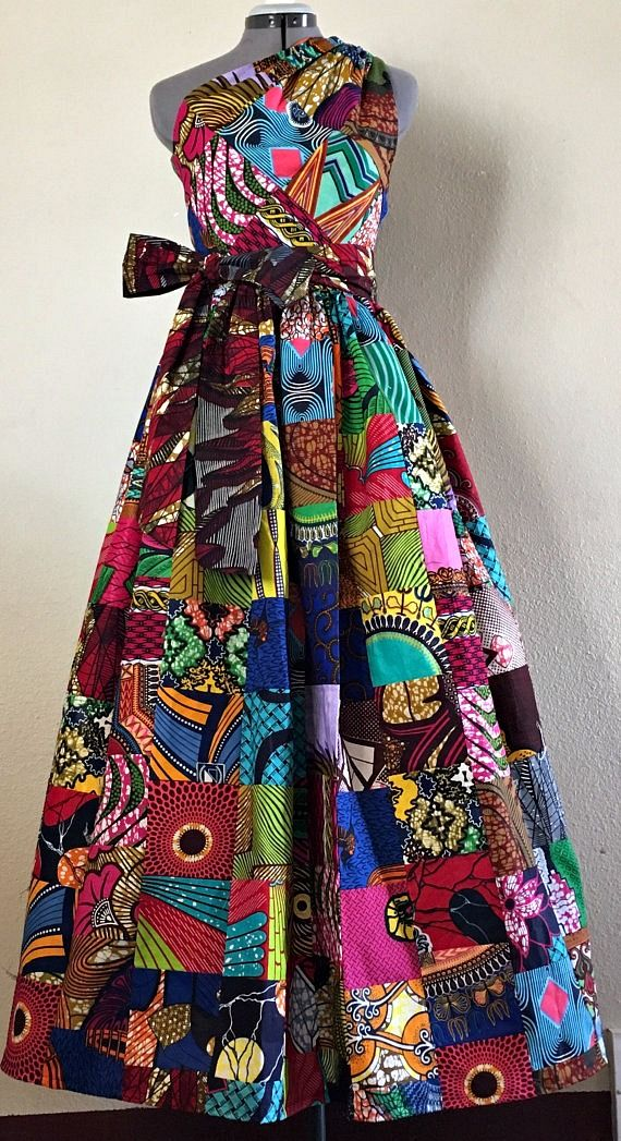 Dazzling African Wax Print Parchwork One Shoulder Dress With Pockets and Tie Belt 100% Cotton. Very Regal, very beautiful, and very unique! This dress is a beautiful and flattering cut and is enhanced to new heights being constructed of handmade patchwork from African Wax.   Ankara | Dutch wax | Kente | Kitenge | Dashiki | African fashion | Ankara bomber jacket | African prints | Nigerian style | Ghanaian fashion | Senegal fashion | Kenya fashion | Nigerian fashion (affiliate)