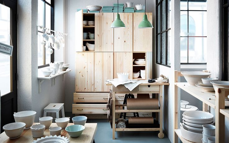 A porcelain boutique with wall cabinets, chest of drawers and trolley in solid wood - IVAR Storage Combination