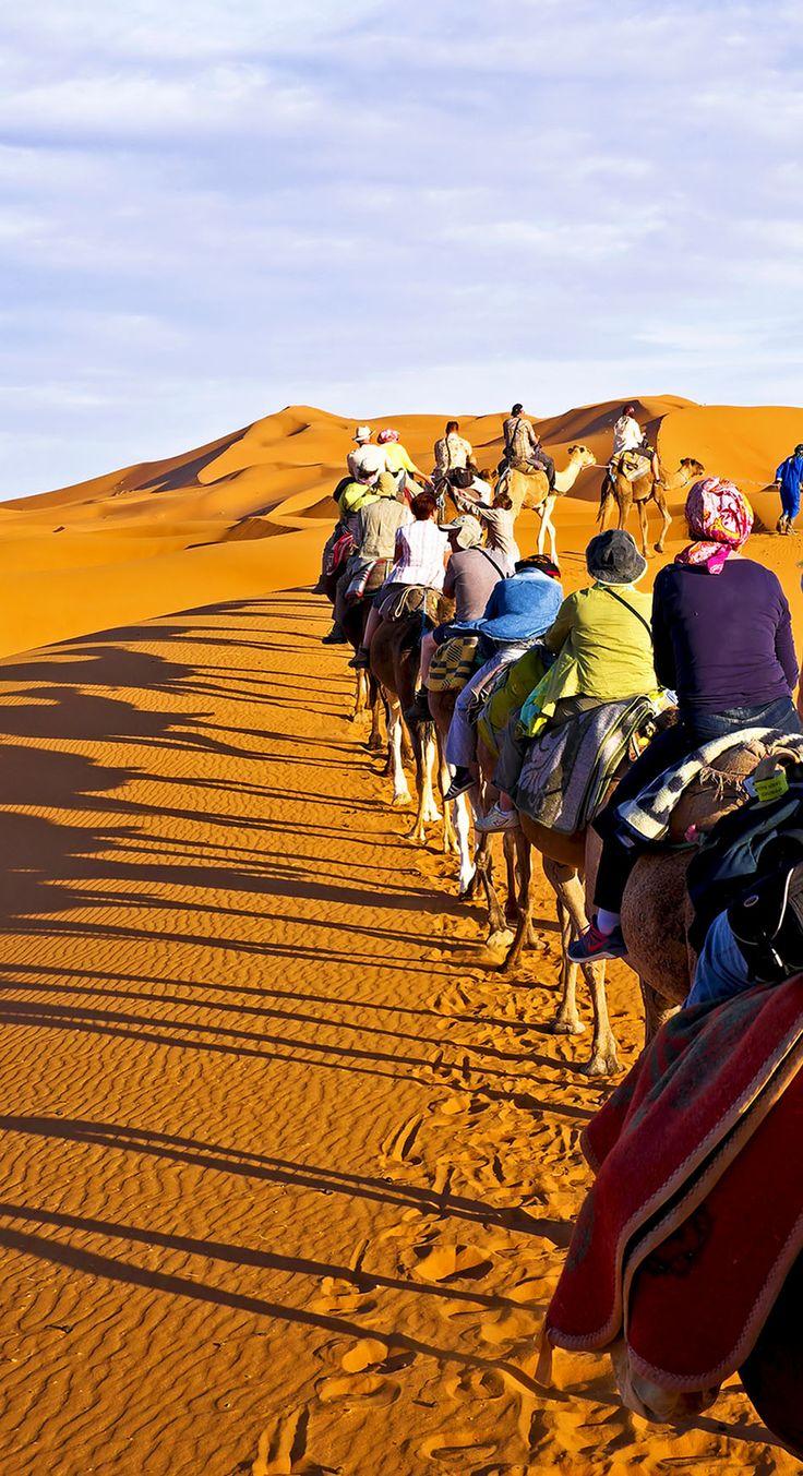 Riding Camels in a Caravan through the sand dunes in the Sahara Desert, Morocco !         20 Photos that Prove Morocco is a Dream Destination