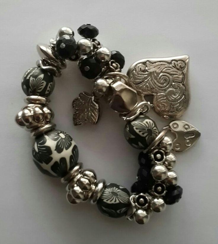 Beaded bracelett with charms