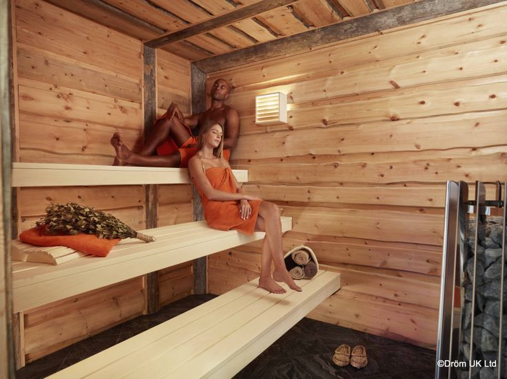 Dröm UK's 'Kelo' sauna is constructed from one of the most exclusive timbers available.   Using the sawn edge and the wane of 80-100 year old dead standing pines from Finland, this sauna is both rustic and decadent.  Pine box lampshades and a wood burning stove complete the traditional feel of the room.