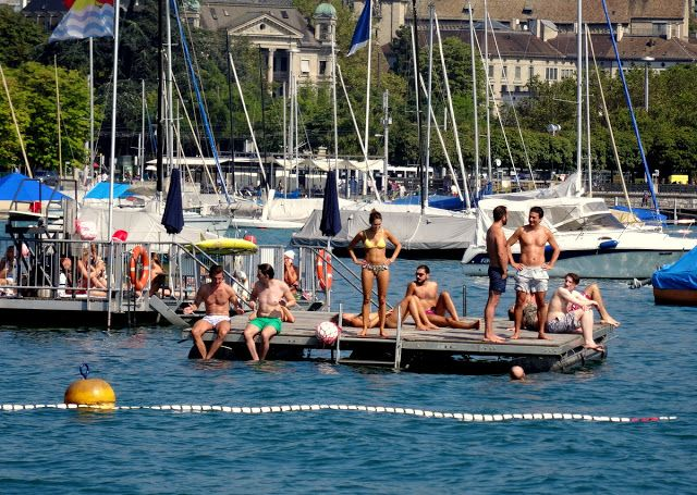 Hanging out and sunbathing on the pontoon of Seebad Enge in Zurich, Switzerland