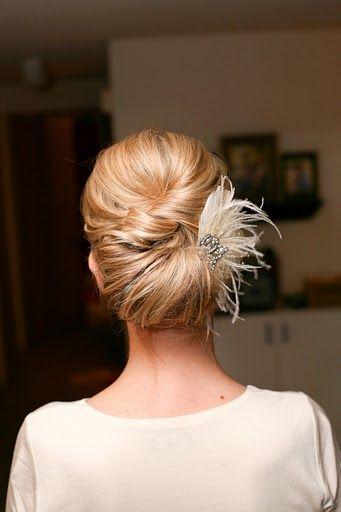Brides hair? Love the feather:)