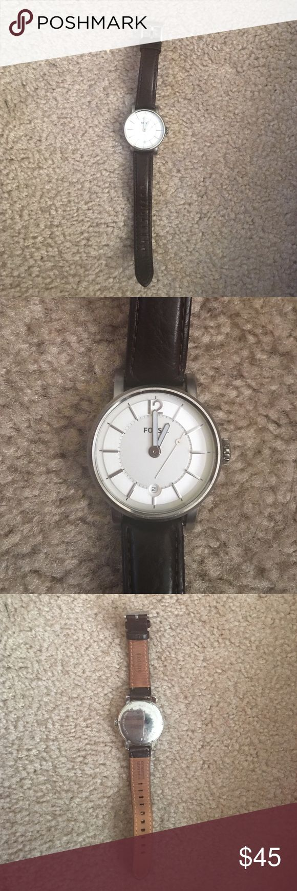 Fossil watch Brown leather band with a silver dial. Worn only twice. Second hand of watch is broken (as seen in pic above). Watch is still covered under Fossils warranty so it can be repaired at no charge (only a $9 shipping and handling charge) Fossil Accessories Watches