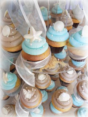 White Chocolate Sea Shell toppers - perfect for your beachy summer wedding!