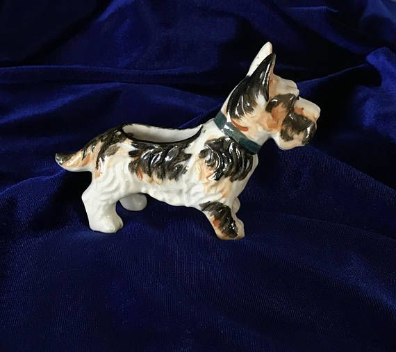 1940's Scottish terrier marked Occupied Japan. A beautiful ceramic collectible! This piece was most likely made to be a pin cushion. We have had other similar pieces with the cushion still in place and the hole is too small for this to be a planter. In excellent condition. No chips