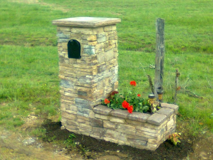Stone mailbox with planter.
