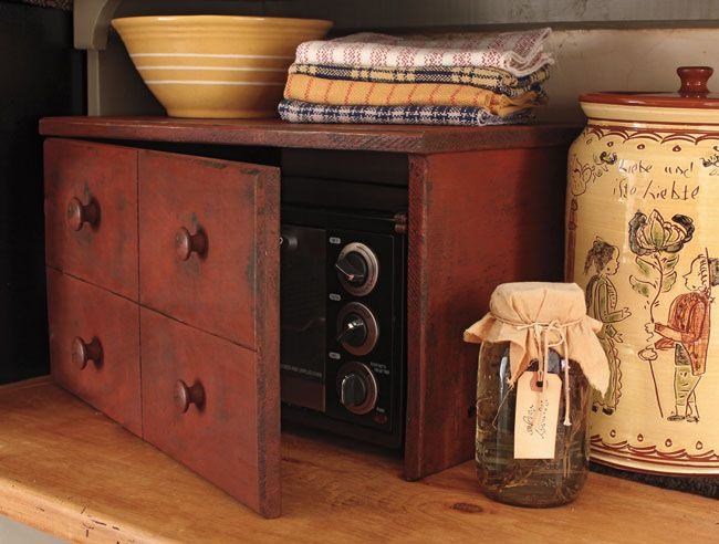 "Our Toaster Oven Cover features an apothecary style door with 4 sections and measures 20¾""w by 11½""h by 14""d. Fits Toasters up to 17¼""w by 10¼""h by 12½""d. Wonderfully aged Red over Black finish.    Remove Toaster Oven while in use and allow to cool completely before sliding back in. $149"