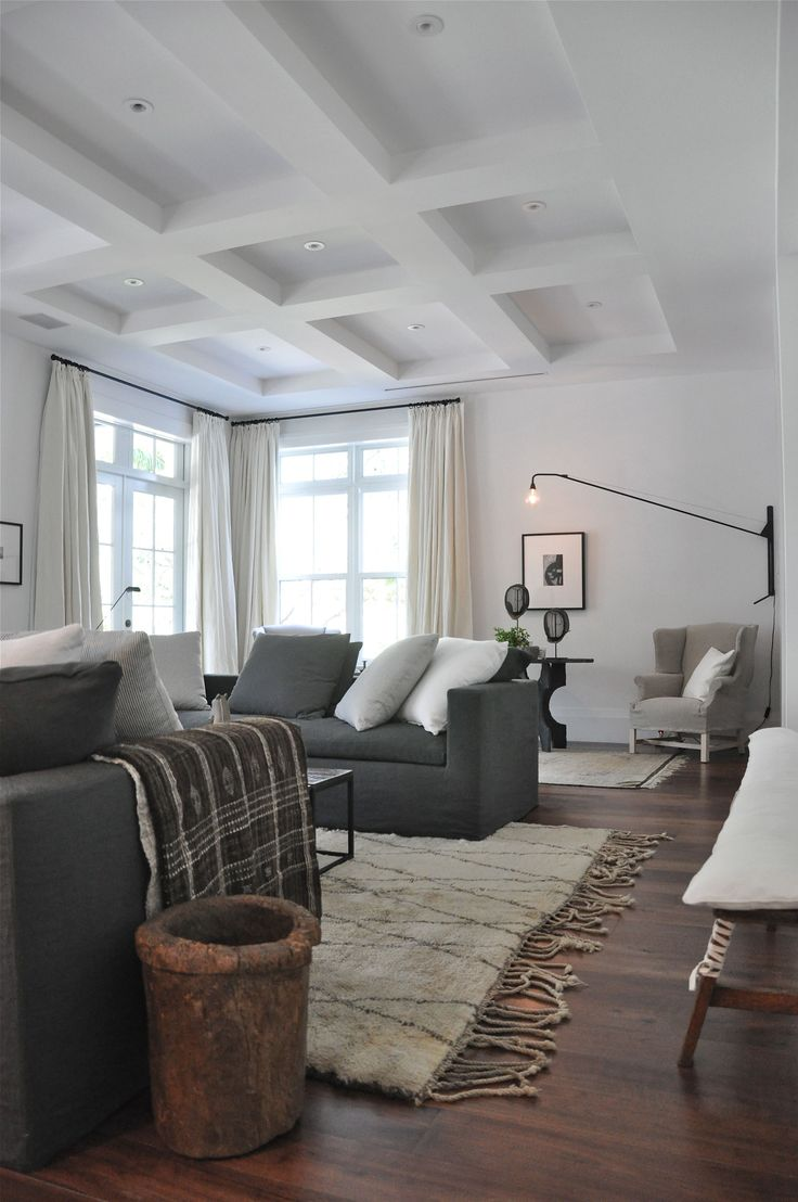Have to do something with the ceiling in one of the rooms downstairs - needs a little touch** Grey and neutral sitting room with rustic touches, by briggs solomon
