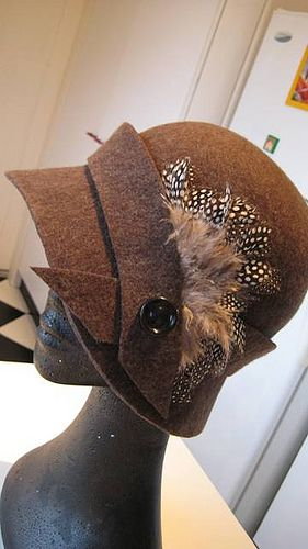 Cloche hat... Feather & button detail. A bit much together? But I like the ideas
