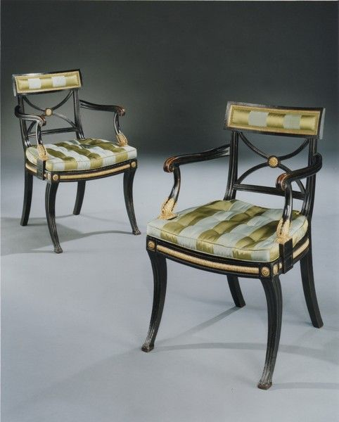 "A pair of Regency period elbow chairs in the manor of Thomas Hope Ca1780 England. 34""H x 22""W x 21""D."