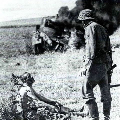 Operation Barbarossa, a knocked out Russian BA-10 armoured car is engulfed in the background - pin by Paolo Marzioli
