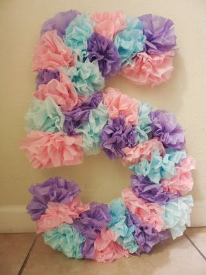 Tissue paper, cardboard cut into a number or initial and a hot glue gun. Fun & easy.