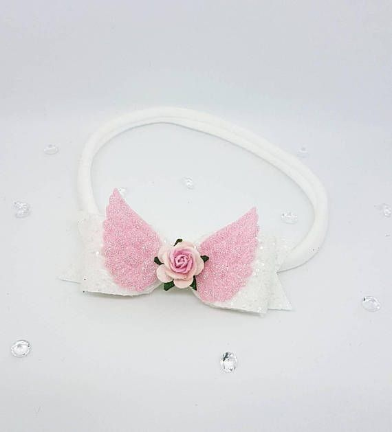 ♥ One really cute handmade white and pink angel rose Headband♥ This stunning headband features a white and pink glitter bow with angel wings and a pink rose embellishment centered in the middle. Attached to a white nylon headband. Made with high quality glitter fabric. The Nylon