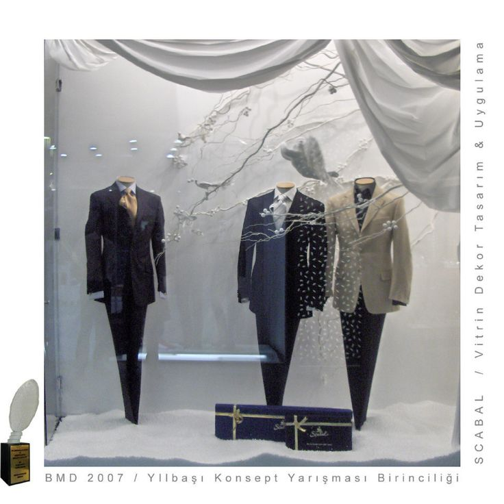Display Window/Designed by Cem İnciThe Scabal store in Istanbul, Turkey has opened in 2006 and is located in the luxury mall Kanyon. It is owned and run by Scabal's long standing Turkish partner Imaj Tekstil and has recently won an award for it's original window display.