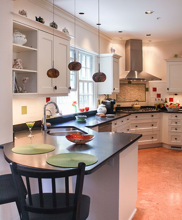 Traditional Kitchen-  Stainless steel appliances, table style seating at counter height for 2, custom tile backsplash, corner sink and corner stove, granite countertops with white cabinets