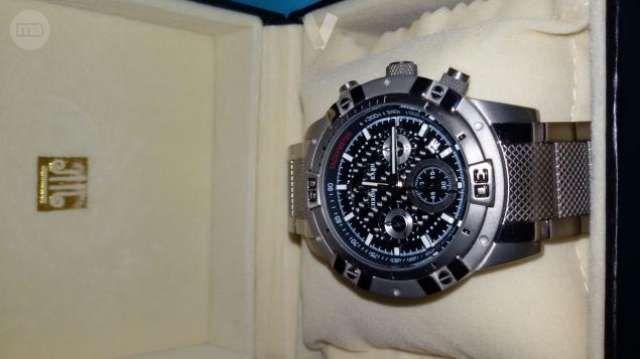 . Se vende reloj de coleccion,marca Lanscotte a estrenar,reloj de fibra de carbono y correa de titanium,sumergible a 10 atmosferas.