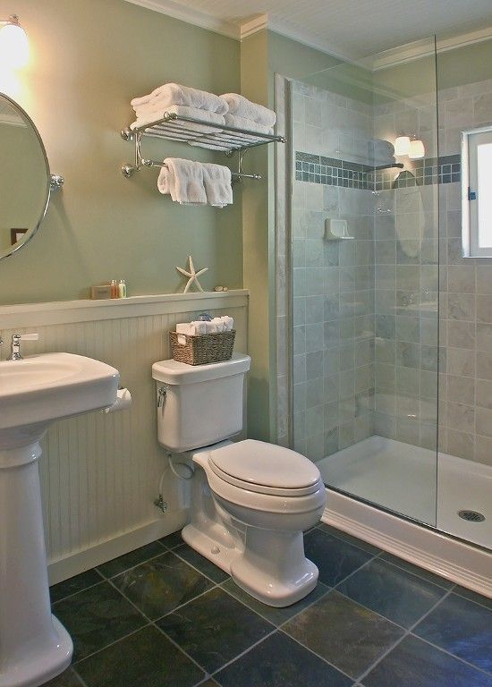 The bath has vintage style fixtures and a roomy walk-in shower. Love the beadboard which would tie in with the adjoining kitchen/dining area. I think this would make our small bath look much more open.