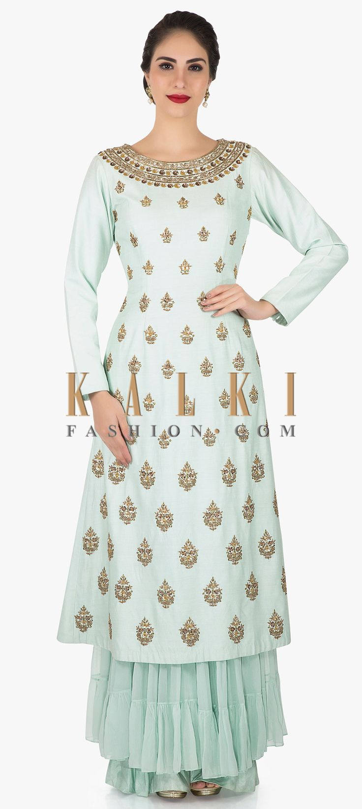 Buy Online from the link below. We ship worldwide (Free Shipping over US$100)  Click Anywhere to Tag Mint Palazzo suit adorn in heavy zardosi and sequin work only on Kalki With the elegance it portrays this mint palazzo suit is perfect for your evening dinner parties. The mint top is featured in santoon fabric whereas the bottom comes in georgette. The suit is embellished in zardosi work and sequin detailing. The palazzo showcases the trendy ruffles at the bottoms.