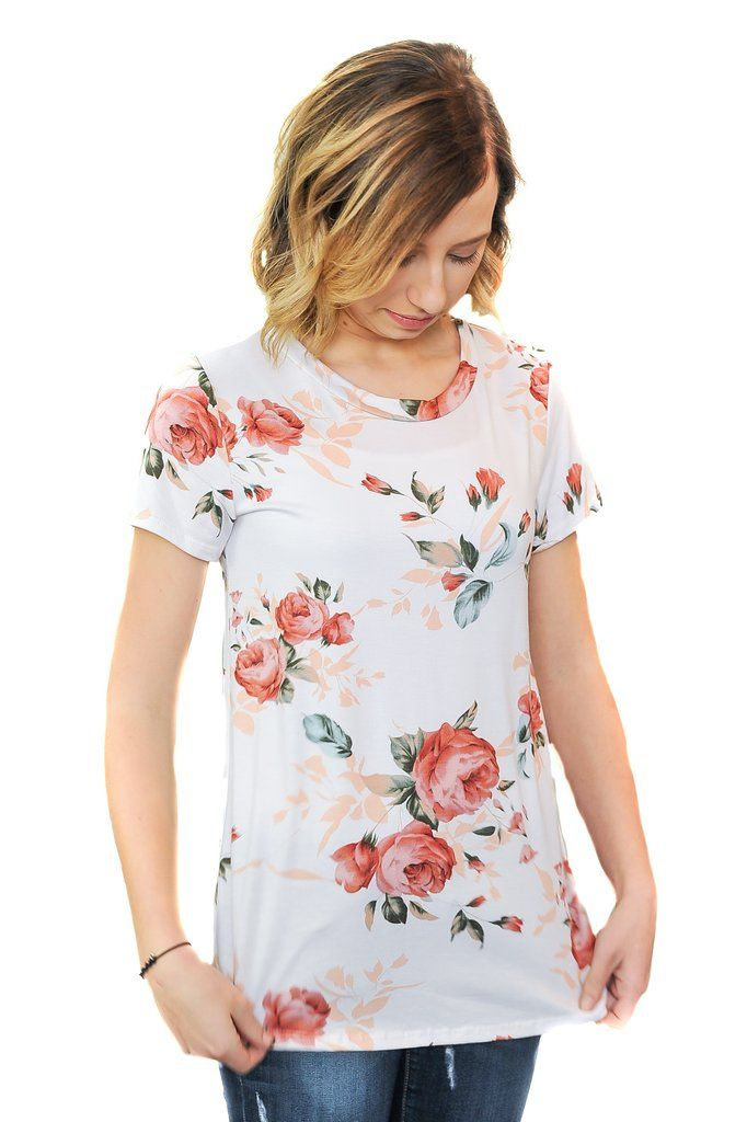 You will love the boyfriend fit of this floral tee. Dress it up or wear it as casual. Great with jeans, skirts, shorts, etc. Choose from either Ivory or Navy. Made of 95% rayon, 5% spandex. Comes in s