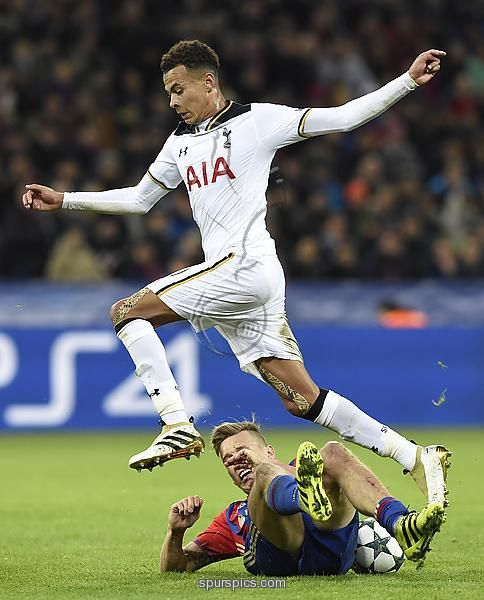Tottenham Hotspur's English midfielder Dele Alli (top) vies with CSKA Moscow's Swedish midfielder Pontus Wernbloom during their Champions League football match between CSKA Moscow and Tottenham Hotspur at the CSKA arena in Moscow on September 27, 2016