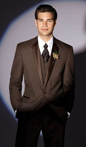 A brown tux, probably Tyler's pick- he wore one to our prom & it looked awesome!