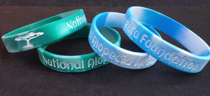 Learn more about The National Alopecia Areata Foundation (NAAF) a non-profit organization which supports research to find a cure or acceptable treatment for alopecia areata, supports those with the disease, and educates the public about alopecia areata. Amazing Wristbands is honored to have them as a customer! Get custom swirled bands here http://www.amazingwristbands.com/extras/Swirled-Wristbands