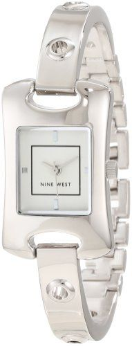 Nine West Women's NW/1305SVSB Curved Silver-Tone Case Grommet Bangle Watch Nine West. $49.00. 8 mm wide thin, silver-tone bangle with grommet hole details, adjustable link bracelet back and jewelry clasp closure. Stainless-steel crown and curved, scratch resistant mineral crystal. Silver-tone sandblast dial with silver-tone markers at 3, 6, 9 & 12; silver-tone inner square. Silver-tone hour, minute and second hands. 20 mm wide polished silver-tone rectangle shap...