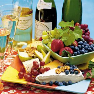 An Easy Party You Can Do: part 2 of 2 Supporting Cast Wine and cheese are best served with simple accompaniments such as these. Crusty bread and crackers: French baguette, Italian bread, plain crackers (all wrapped in a clean cloth to keep them from drying out) Fresh fruit: grapes, melons, pears, apples, berries, figs Nuts: pecans, almonds, walnuts, macadamias Assorted olives, pickled vegetables, or cured meats such as sliced country ham and sausage