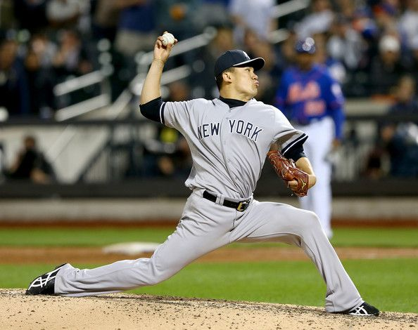 Masahiro Tanaka #19 of the New York Yankees delivers a pitch in the ninth inning against the New York Mets during interleague play on May 14...