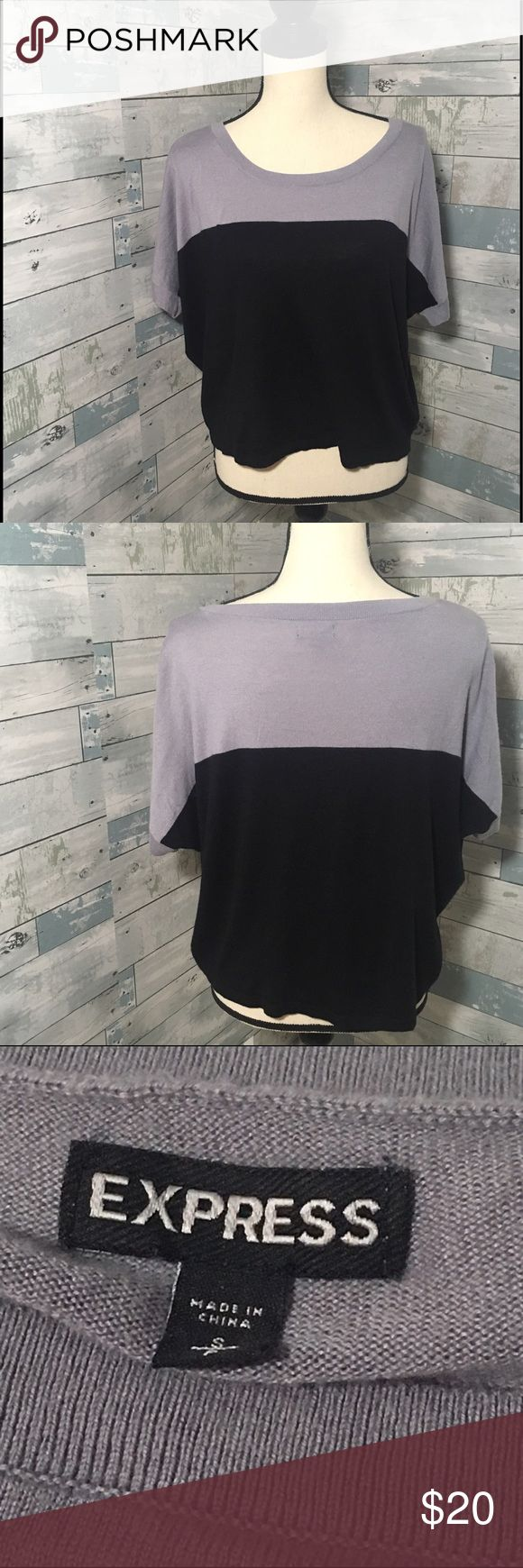 """Express Batwing short sleeve tee Gray and black blocked batwing short sleeve tee from Express. Very soft, 40% Rayon/30% Nylon/25% Polyester/5% Cashmere. EUC, size Small, Bust 52"""", Length 19"""".                                        🚭Smoke Free Home🚭 ✅Offers Welcome on All Purchases ✅Ships Every Friday  📏Measurements Taken Flat ❌Off-Posh Transactions ❌Trade Express Tops Tees - Short Sleeve"""