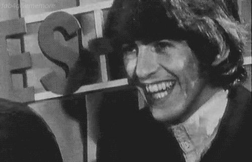 """george-harrison-marwa-blues:  """"We laughed a lot. That's one thing we forgot about for a few years - laughing. When we went through all the lawsuits, it looked as if everything was bleak, but when I think back to before that, I remember we used to laugh all the time."""" ——George Harrison, The Beatles Anthology Gif courtesy of giphy.com"""