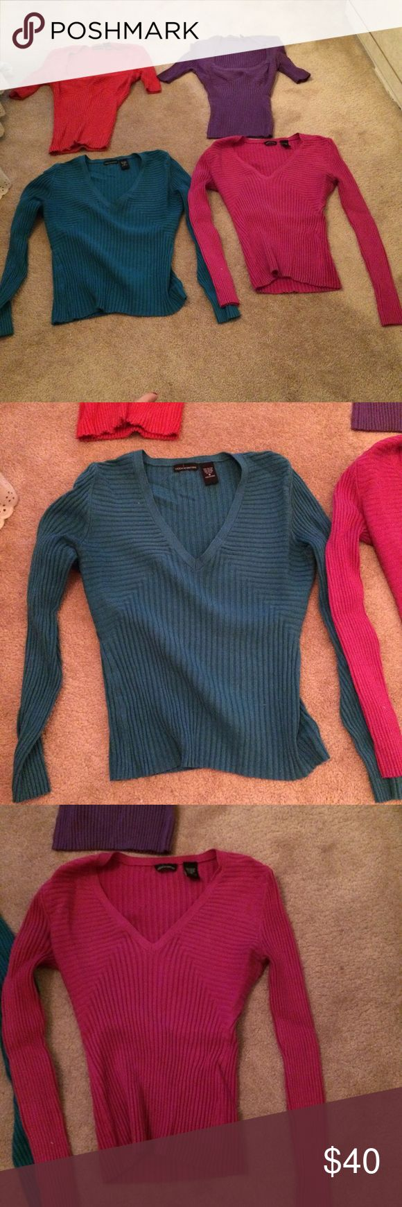Final sale Four Victoria Secret Sweaters Four Victoria Secret Sweaters.  I am trying to down size these are all in good condition.  Feel free to make an offer.  They are green fuchsia red and purple .  Two long sleeve and two short sleeve.  Final sale 20 dollars .  I will throw in a free size medium barely used lace camisole also from Victoria Secret. Victoria's Secret Tops