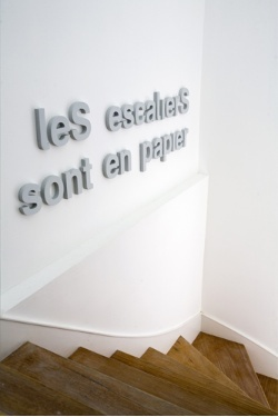 "using big letters in stairs... meaning : ""stairs are in paper"" it's a french childhood song"