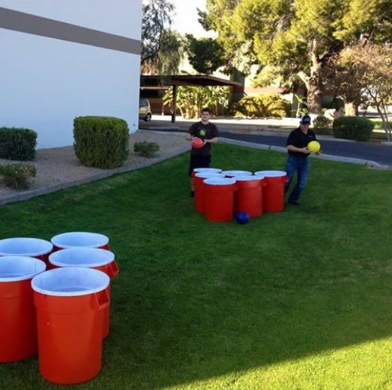 "Giant ""Beer"" Pong game! Obviously these would be empty or filled with a little water. Fun for outdoor party- make penalty of missing something silly like you have to do a headstand."