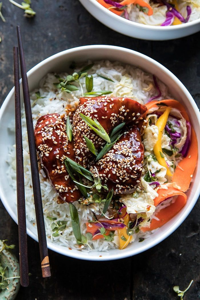 1. In the bowl of your crockpot, combine 2 tablespoons water, the soy sauce, honey, Gochujang, sesame oil, ginger, and garlic. Add the chicken, tossing to coat. Cover and cook on LOW for 6-7 hours or on HIGH for 4-6 hours. If the sauce needs thickening, turn the heat to high and cook uncovered for 30 minutes.  Finish as directed above.