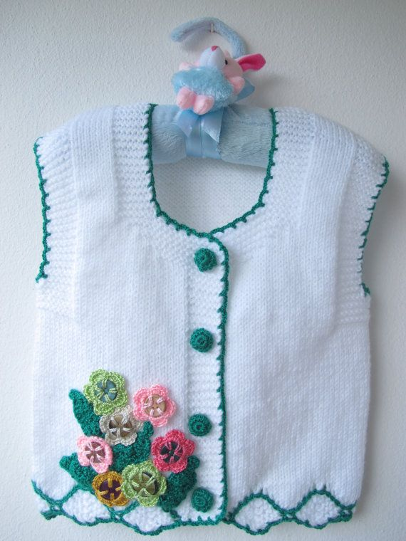 Hey, I found this really awesome Etsy listing at https://www.etsy.com/listing/239311439/hand-knitted-baby-vest-flowers-baby-girl