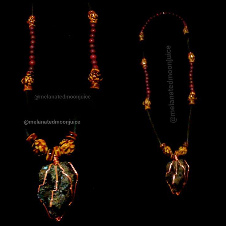 Handmade Rare Melanite Garnte wrapped in pure copper  Price 150.00
