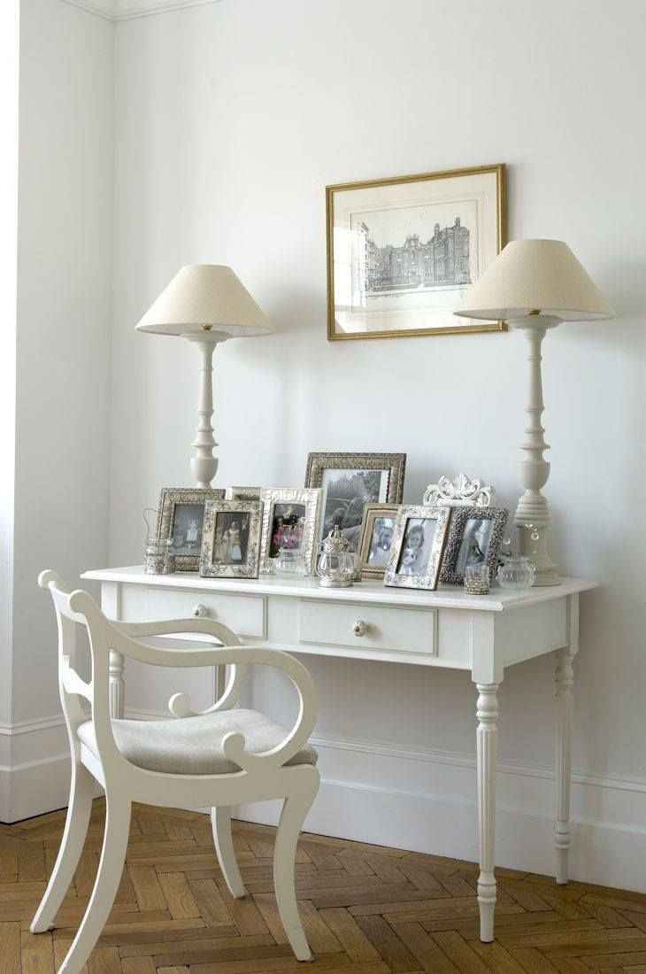 21 best white and silver bedroom images on pinterest bedroom herringbone parquetry and white paint a pair of lamps anchor photos displayed on the console