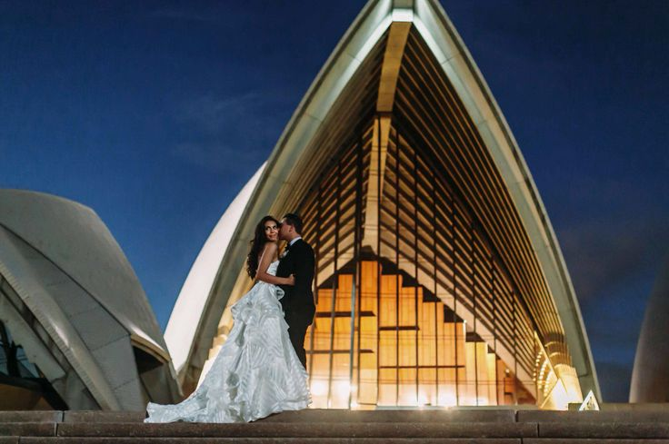 Love under the Sydney Opera House.  Photographer: Chris Prestige, At Dusk Photography. #sydneyoperahouse #operapointmarqueeweddings #sheglowsHP #guindongown