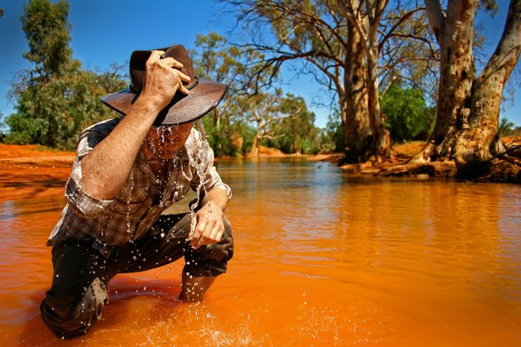 A swollen creek bed in the desert near Broken Hill in Australia, a local cools off. (Miles Rowland, National Geographic Traveler Photo Contest).  photography