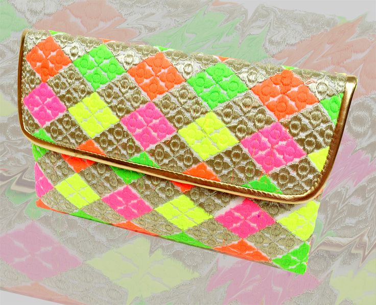limited stock!! Now you can Buy and shop On whatsapp @ Reasonable Prices, Kindly Add us on :+91-9582282314 Price: 1299 Rs  only✅ Designer Clutch neon look with sling Hurry Now, Order now!!! Complimentary Gifts on your First whatsapp Order
