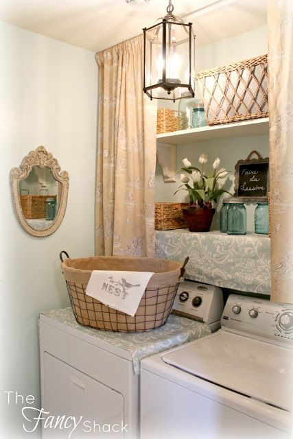 Lovely laundry room (pretty and very organized)!