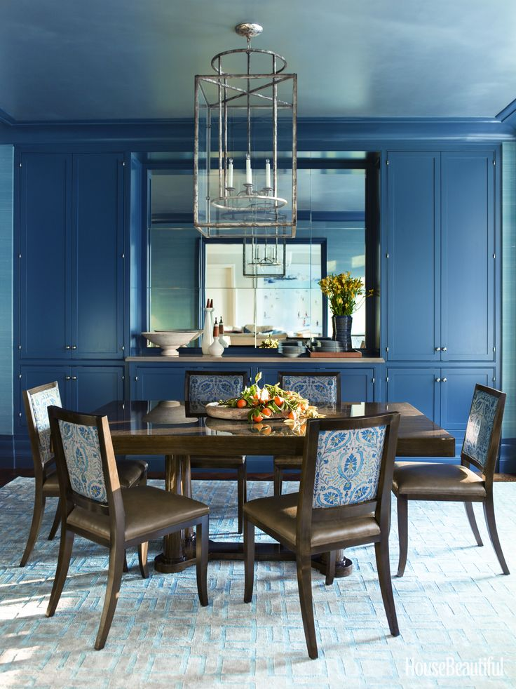 Inside A Manhattan Apartment Thats Not Afraid Of Color Corner CabinetsWall CabinetsDining Room BlueDining