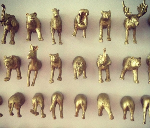 Animal Magnets- cut plastic animal figures in 1/2, paint w/metallic spray paint, add magnet.....hooray!!