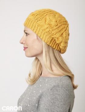 Яркая шапка спицами для женщин, выполненная из акриловой пряжи средней толщины. Вязание шапки начинается от нижнего края по кругу, далее...