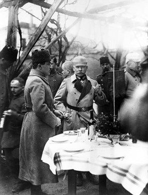Ismail Enver Pasha (1881-1922), Turkish leader, and General Arnold von Winkler (or Winckler, 1856-1945), German army officer, eating a hasty lunch on the Macedonian Front during the First World War.