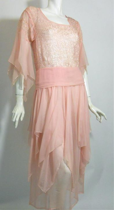 Blush pink silk chiffon early 20s dress with handkerchief hem and sleeves. Embroidered bodice, silk sash at waist with side buttons.