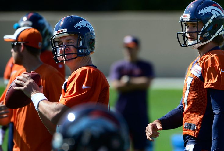 Description of . ENGLEWOOD, CO - SEPTEMBER 5: Quarterbacks Peyton Manning, left, and Brock Osweiler, right, run through a few passing drills. The Denver Broncos Football team practices at Dove Valley in Englewood in preparation for Sunday's season opener against the Indianapolis Colts. (Kathryn Scott Osler/The Denver Post)-- #ProFootballDenverBroncos